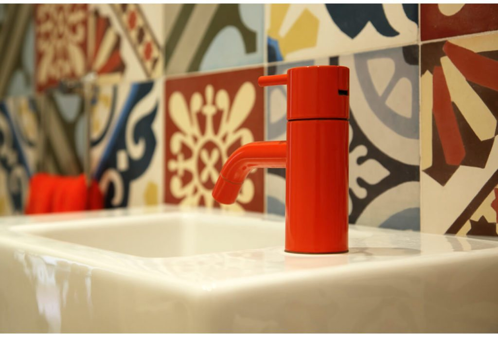 Beautiful Red Tap Shot with Patterned Tiles: French Country House