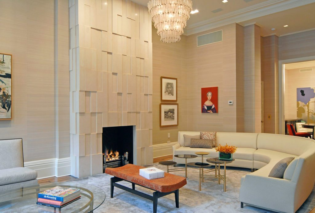 Reception View of New York City Brownstone Property: Fireplace and Sofas
